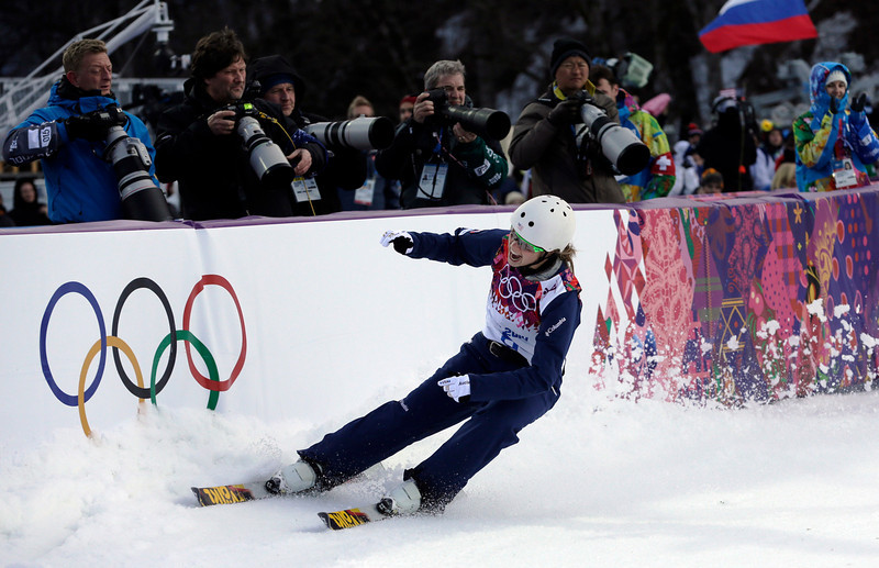 . Ashley Caldwell of the United States reacts after a jump during the women\'s freestyle skiing aerials qualifying at the Rosa Khutor Extreme Park, at the 2014 Winter Olympics, Friday, Feb. 14, 2014, in Krasnaya Polyana, Russia. (AP Photo/Andy Wong)