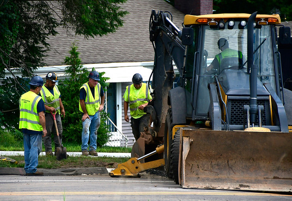 8/3/2018 Mike Orazzi | Staff A water main break closed Maple Avenue near the intersection with Burlington Avenue Friday.