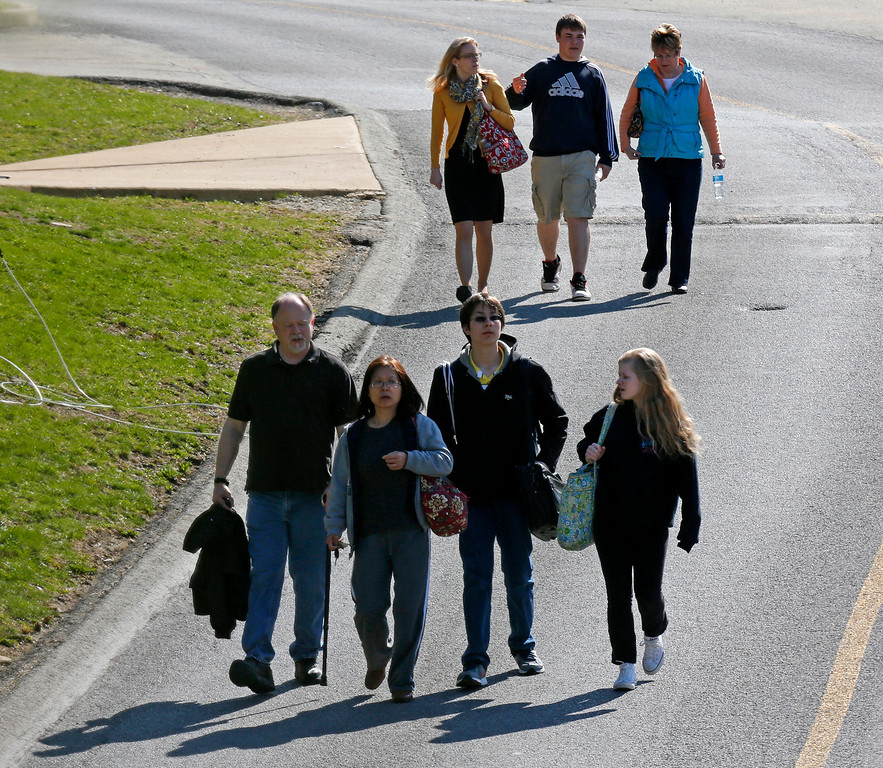 . Students are escorted from the campus of the Franklin Regional School District after more then a dozen students were stabbed by a knife wielding suspect at nearby Franklin Regional High School on Wednesday, April 9, 2014, in Murrysville, Pa., near Pittsburgh. The suspect, a male student, was taken into custody and is being questioned. (AP Photo/Gene J. Puskar)