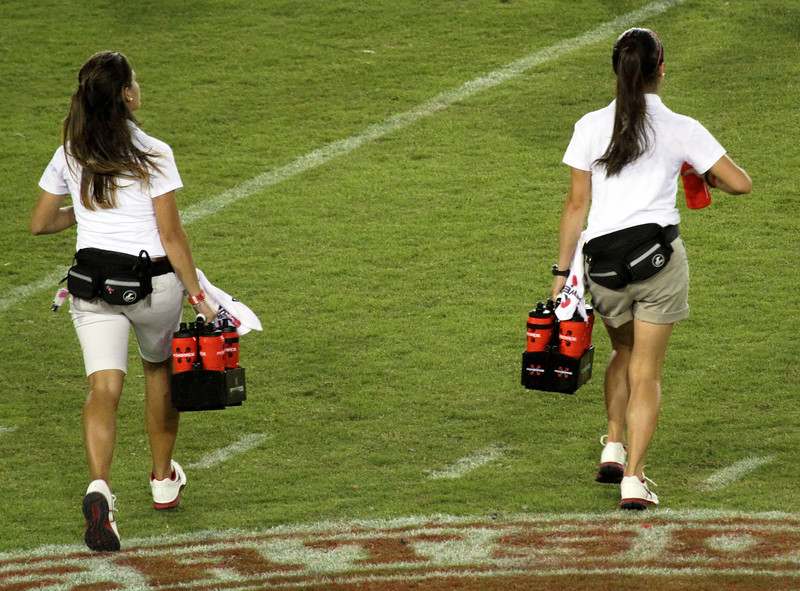 Carrying water to UH players during a time out
