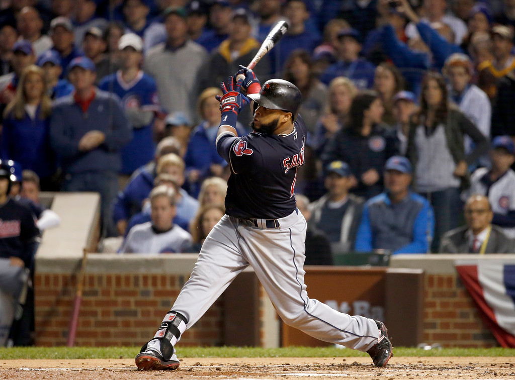 . Cleveland Indians\' Carlos Santana hits a home run during the second inning of Game 4 of the Major League Baseball World Series against the Chicago Cubs, Saturday, Oct. 29, 2016, in Chicago. (AP Photo/Nam Y. Huh)