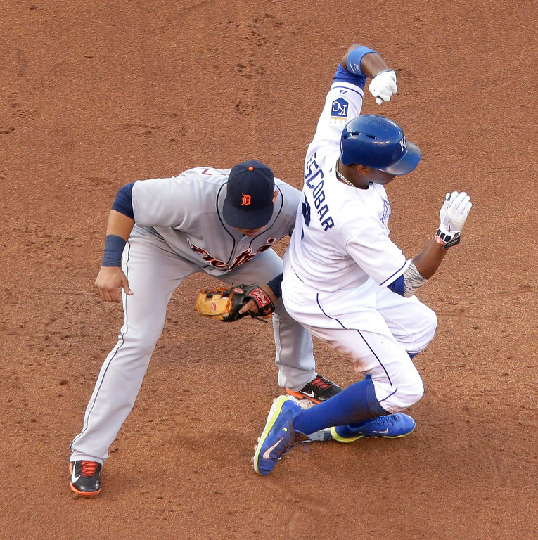 . Kansas City Royals\' Alcides Escobar beats the tag by Detroit Tigers shortstop Eugenio Suarez to steal second base during the second inning of a baseball game Thursday, July 10, 2014, in Kansas City, Mo. (AP Photo/Charlie Riedel)