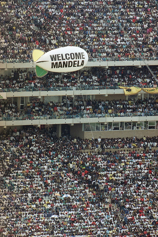 . A balloon bearing a welcome sign for Nelson Mandela airborne over Soweto\'s Soccer City stadium, where the recently released ANC leader addressed the crowd of 120,000 packed into the venue, Tuesday, Feb. 13, 1990. Mandela was released from prison after serving over 27 years. (AP Photo/Sean Woods)