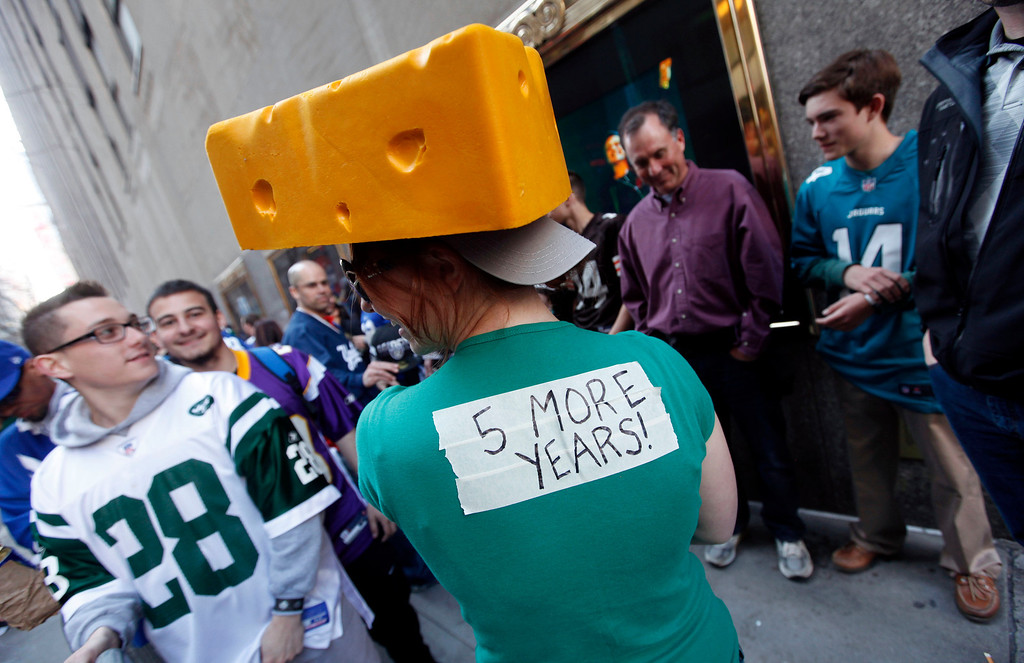. A Green Bay Packers fan waits in line outside Radio City Music Hall before the first round of the NFL football draft on Thursday, April 25, 2013, in New York. (AP Photo/Jason DeCrow)