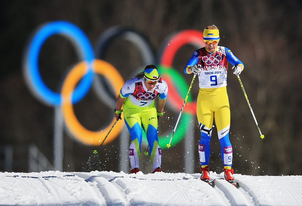 . Nika Razinger of Slovenia (L) and Tetyana Antypenko of Ukraine compete in the Women\'s 10 km Classic during day six of the Sochi 2014 Winter Olympics at Laura Cross-country Ski & Biathlon Center on February 13, 2014 in Sochi, Russia.  (Photo by Richard Heathcote/Getty Images)