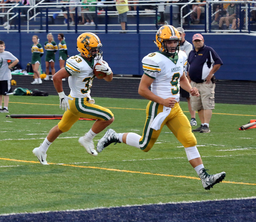 . David Schneider - The Morning Journal<br> Amherst\'s Dan Makruski scores the Comets\' first touchdown of the game during the first quarter as Jimmy Schill leads the way on Sept. 7.