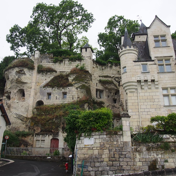 Chateau carved into the cliffside.