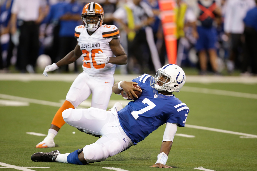 . Indianapolis Colts quarterback Jacoby Brissett (7) slides after a run in front of Cleveland Browns cornerback Jason McCourty (30) during the second half of an NFL football game in Indianapolis, Sunday, Sept. 24, 2017. (AP Photo/AJ Mast)
