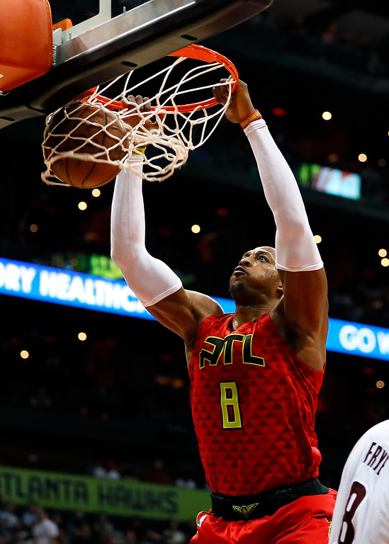 . Atlanta Hawks center Dwight Howard (8) dunks in the first half of an NBA basketball game against the Cleveland Cavaliers, Sunday, April 9, 2017, in Atlanta. (AP Photo/Todd Kirkland)