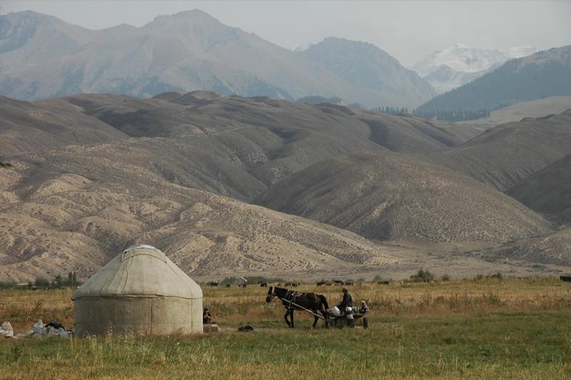 Kyrgyz Farmers and Yurt - Lake Issyk-Kul, Kyrgyzstan
