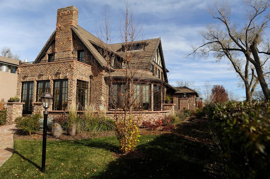 ". DENVER, CO - NOVEMBER 13: The exterior of the Spicer residence on November 13, 2013, in Denver, Colorado. While Jeannine Spicer and June Eshelman completely demolished the interior of the house, they remained dedicated to maintaining the original architectural characteristics of the outside. The house won a 2013 Mayor\'s Design Award in the ""It Just Fits\"" category. (Photo by Anya Semenoff/YourHub)"