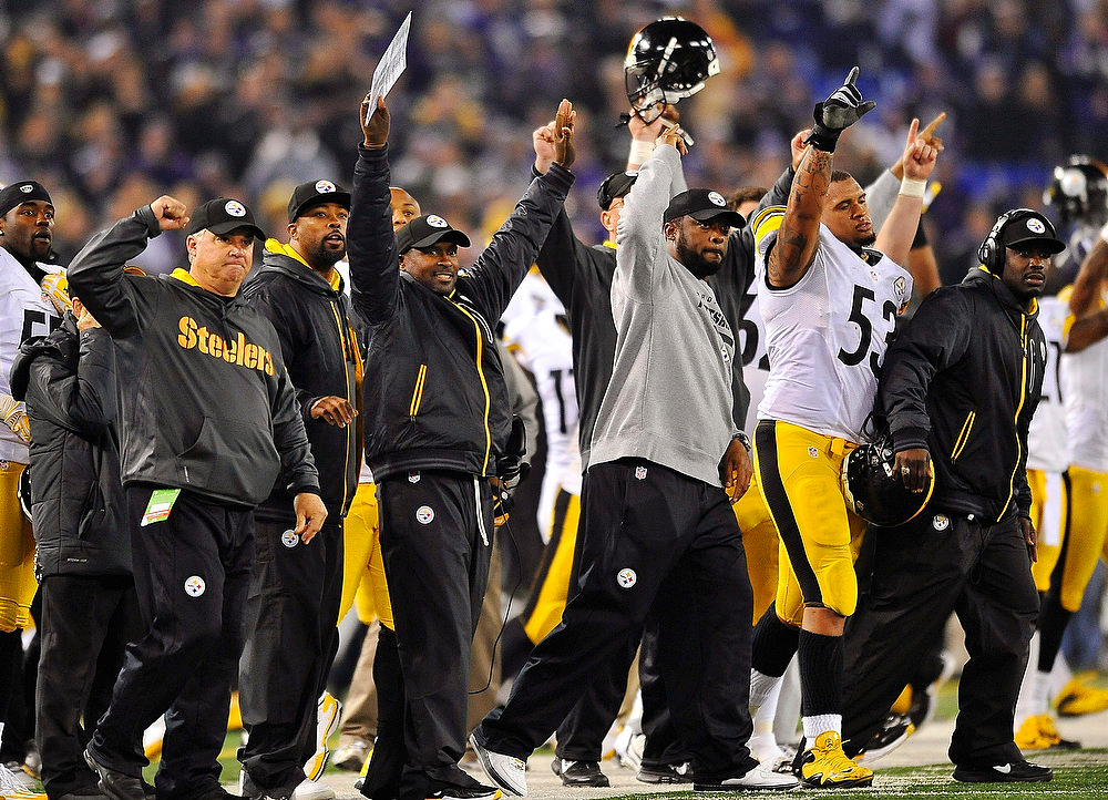 . Pittsburgh Steelers head coach Mike Tomlin, center, joins the rest of the bench in celebrating the winning field goal during the second half of an NFL football game against the Baltimore Ravens in Baltimore, Sunday, Dec. 2, 2012. The Steelers won 23-20. (AP Photo/Gail Burton)