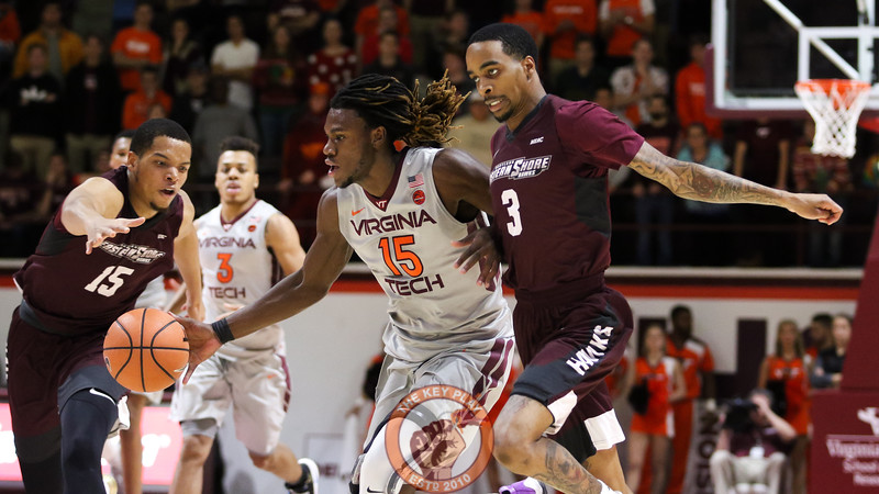 Chris Clarke avoids two UMES defenders late in the second half. (Mark Umansky/TheKeyPlay.com)