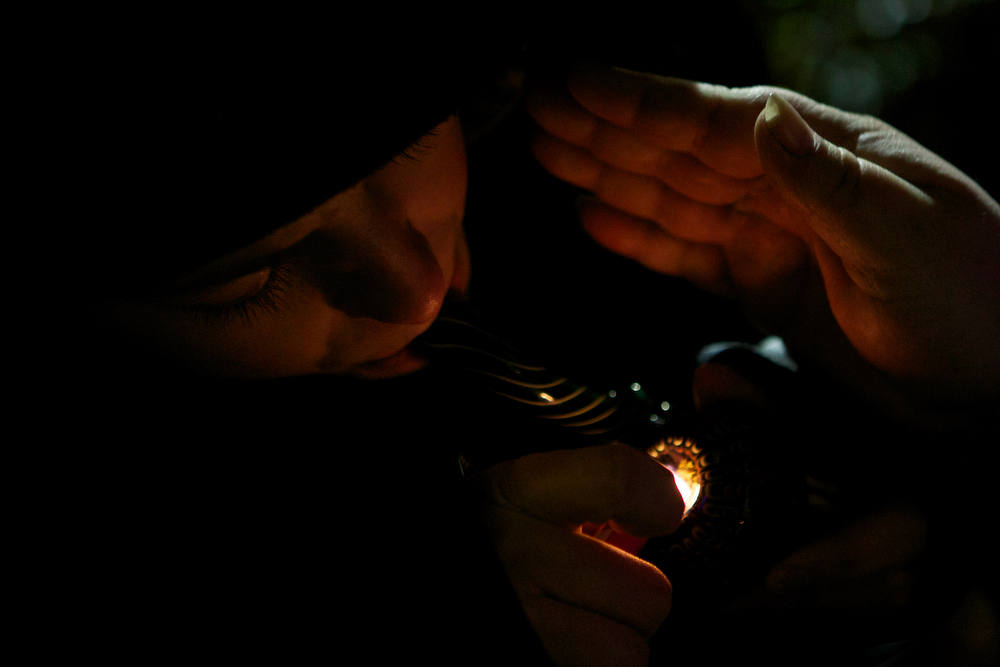 Description of . A resident of Tacoma, Washington smokes marijuana shortly before a law legalizing the recreational use of  marijuana took effect on December 5, 2012 in Seattle, Washington.  Voters approved an initiative to decriminalize the recreational use of marijuana making it one of the first states to do so. (Photo by Stephen Brashear/Getty Images)