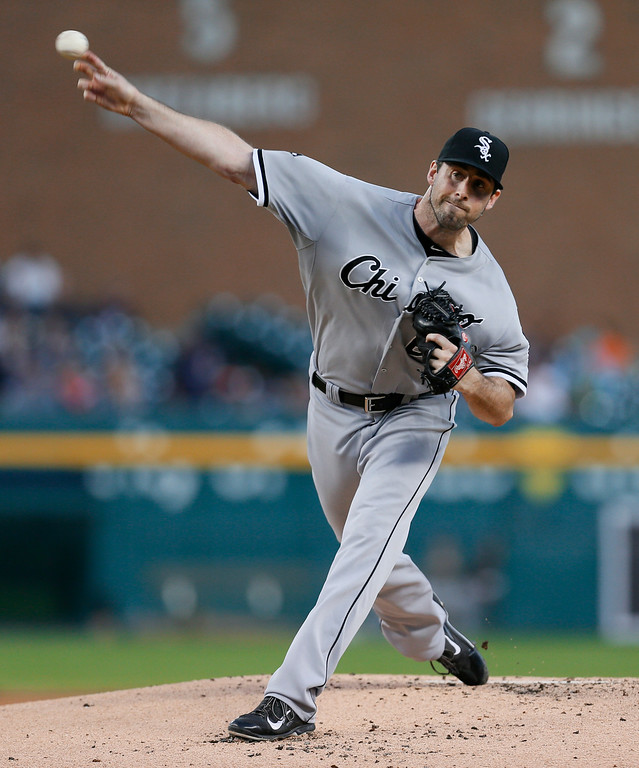 . Chicago White Sox pitcher Scott Carroll throws against the Detroit Tigers in the first inning of a baseball game in Detroit Tuesday, Sept. 23, 2014. (AP Photo/Paul Sancya)