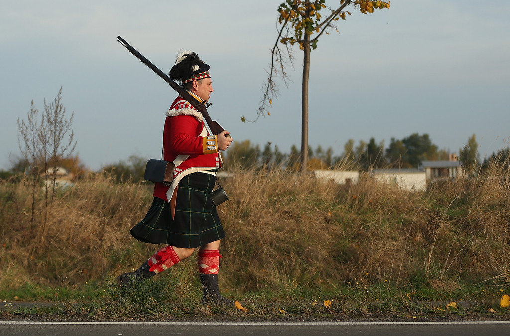 . A historical society enthusiast in the role of a Scottish Northern Highlander soldier arrives to re-enact The Battle of Nations on its 200th anniversary on October 20, 2013 near Leipzig, Germany. (Photo by Sean Gallup/Getty Images)