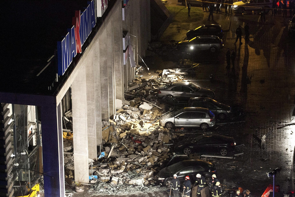 . Cars parked outside the \'Maxima\' supermarket, after its roof collapsed in Riga, Latvia, 21 November 2013.   EPA/EMIL DESJATNIKOV