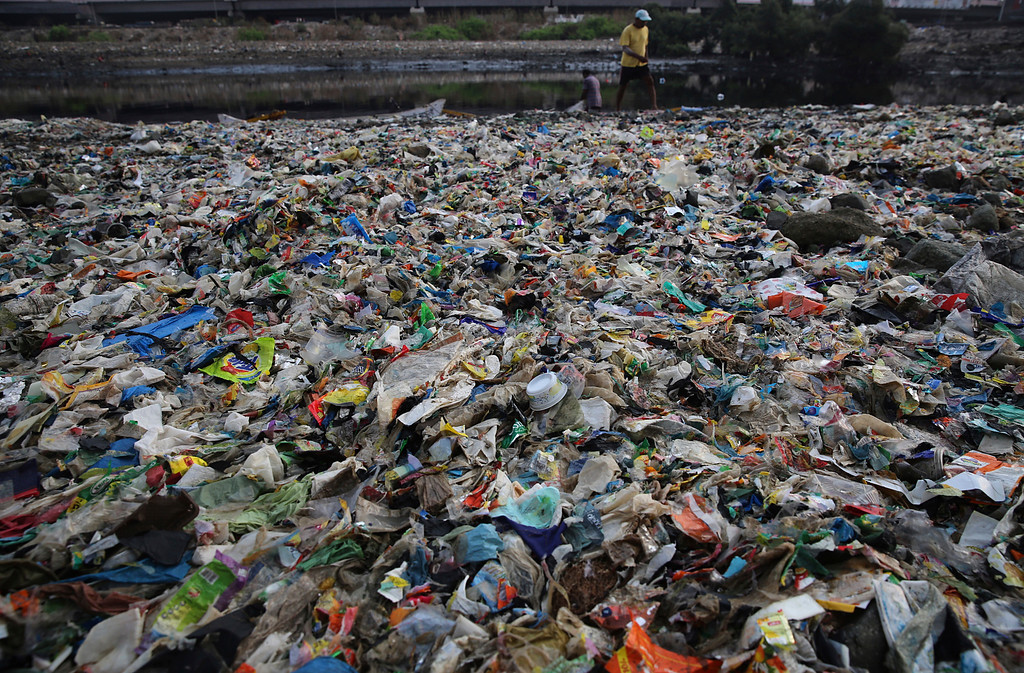 ". A man walks on the shores the Arabian Sea, littered with plastic and other garbage in Mumbai, India, Monday, June 4, 2018. The theme for this year\'s World Environment Day, marked on June 5, is ""Beat Plastic Pollution.\"" (AP Photo/Rafiq Maqbool)"