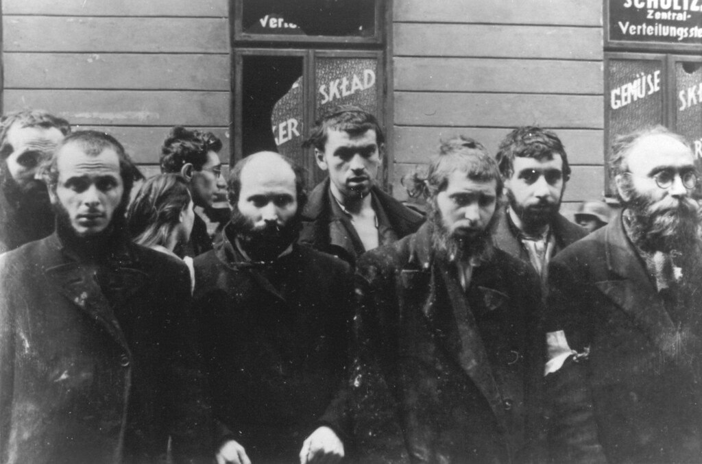 . A group of religious Jews are being held under arrest by German SS soldiers, in April/May 1943, during the destruction of the Warsaw Ghetto by German troops, following an uprising in the Jewish quarter. (AP Photo)