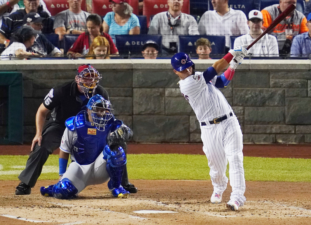 . Chicago Cubs catcher Willson Contreras (40) hits a solo home run in the third inning during the 89th MLB baseball All-Star Game, Tuesday, July 17, 2018, at Nationals Park, in Washington. (AP Photo/Carolyn Kaster)
