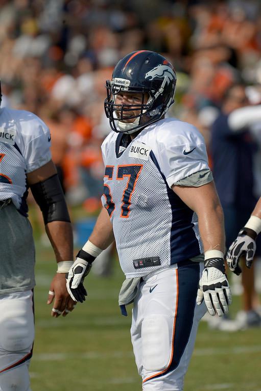 . Denver Broncos C/G Ryan Lilja (57) runs through drills during training camp August 6, 2013 at Dove Valley. (Photo By John Leyba/The Denver Post)