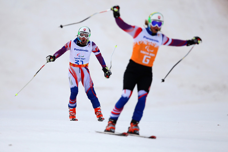 . Radomir Dudas of Slovakia and his guide Michal Cervan react as they cross the line in the Men\'s Downhill - Visually Impaired during day one of Sochi 2014 Paralympic Winter Games at Rosa Khutor Alpine Center on March 8, 2014 in Sochi, Russia.  (Photo by Ian Walton/Getty Images)