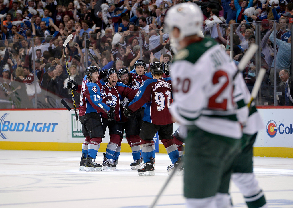 . DENVER, CO - APRIL 26: The Colorado Avalanche celebrate a 3 to 3 tie goal by Colorado Avalanche right wing P.A. Parenteau (15) during the third period of action. The Colorado Avalanche hosted the Minnesota Wild in the fifth round of the Stanley Cup Playoffs at the Pepsi Center in Denver, Colorado on Saturday, April 26, 2014. (Photo by John Leyba/The Denver Post)