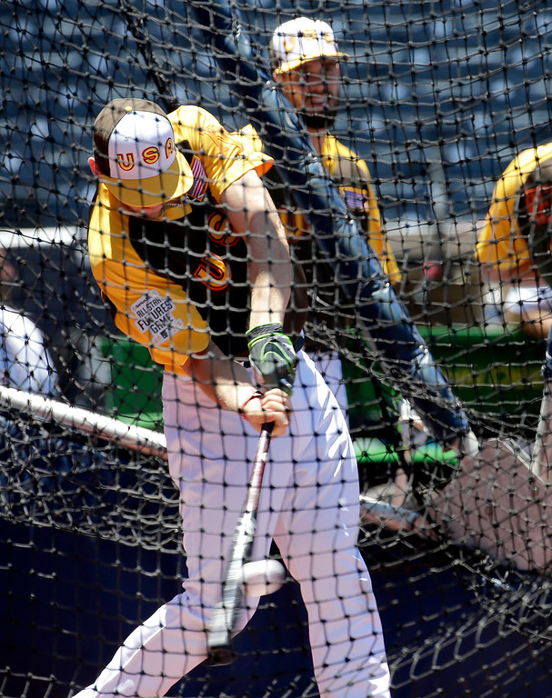 . U.S. Team\'s Hunter Dozier, of the Kansas City Royals, hits prior to the All-Star Futures baseball game against the World team, Sunday, July 10, 2016, in San Diego. (AP Photo/Matt York)