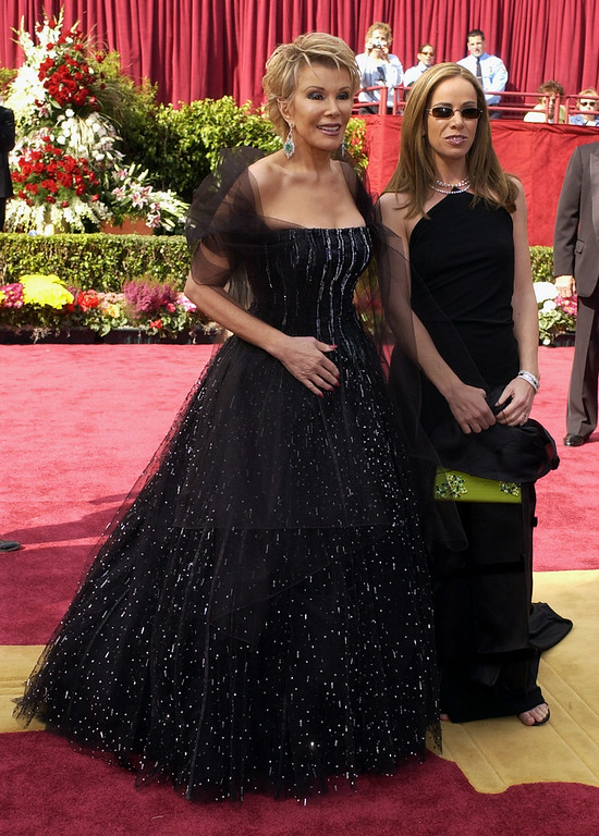 . Joan Rivers, left, and daughter, Melissa, of E! Television arrive at the red carpet before the 74th annual Academy Awards on Sunday, March 24, 2002, in Los Angeles. (AP Photo/Laura Rauch)