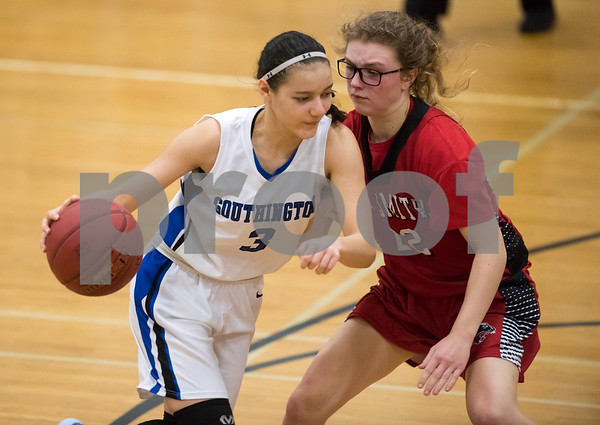 02/15/18 Wesley Bunnell | Staff Southington girls basketball defeated E.O. Smith 68-51 Thursday night at Southington High School in a CCC Tournament contest. Bri Harris (3) guarded by Taylor Verboven (22).