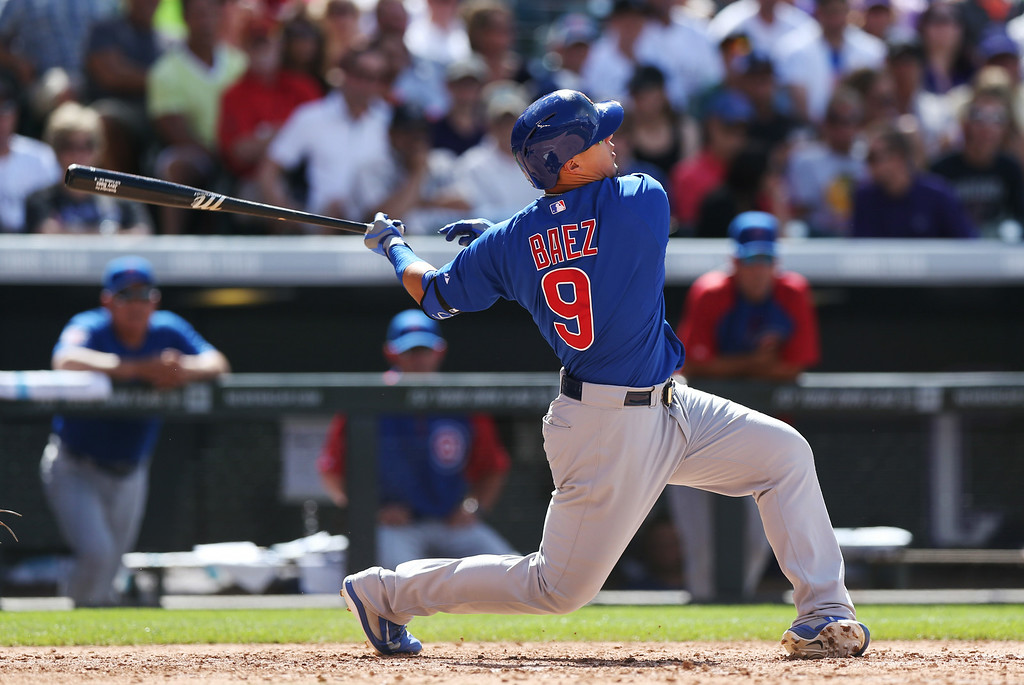 . Chicago Cubs\' Javier Baez watches the flight of his two-run home run against the Colorado Rockies in the eighth inning of the Cubs\' 6-2 victory in a baseball game in Denver on Thursday, Aug. 7, 2014. Baez hit two home runs in the game. (AP Photo/David Zalubowski)