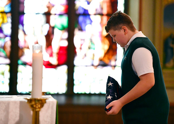 9/11/2019 Mike Orazzi | Staff St. Joseph School 8th grade student Brandon Benoit carries the American flag for the 9/11 ceremony in Bristol on Wednesday morning at St. Joseph Church.