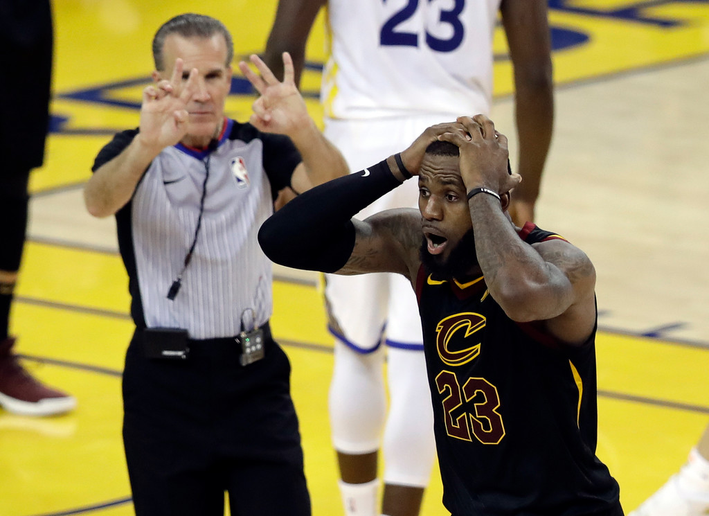. Cleveland Cavaliers forward LeBron James (23) reacts to a call during the second half of Game 1 of basketball\'s NBA Finals between the Golden State Warriors and the Cavaliers in Oakland, Calif., Thursday, May 31, 2018. (AP Photo/Marcio Jose Sanchez)