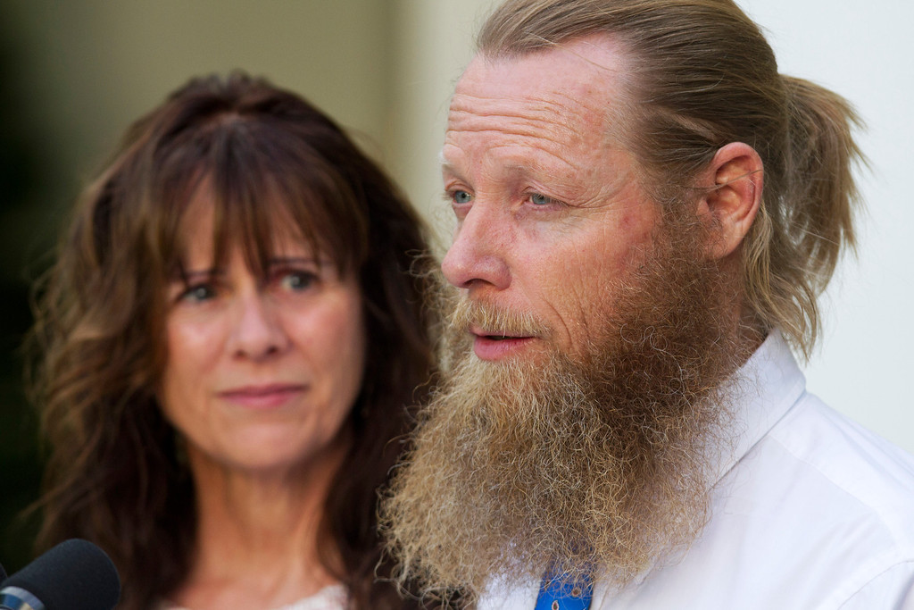 . Parents of U.S. Army Sgt. Bowe Bergdahl, Bob Bergdahl, right, and Jani Bergdahl, speak about his release during a news conference with President Barack Obama in the Rose Garden of the White House in Washington on Saturday, May 31, 2014. Bergdahl, 28, had been held prisoner by the Taliban since June 30, 2009. He was handed over to U.S. special forces by the Taliban in exchange for the release of five Afghan detainees held by the United States. (AP Photo/Jacquelyn Martin)