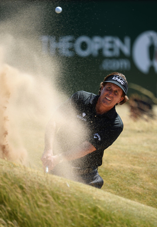 . Phil Mickelson of the United States plays out of a bunker on the 17th hole during the first round of the 142nd Open Championship at Muirfield on July 18, 2013 in Gullane, Scotland.  (Photo by Stuart Franklin/Getty Images)