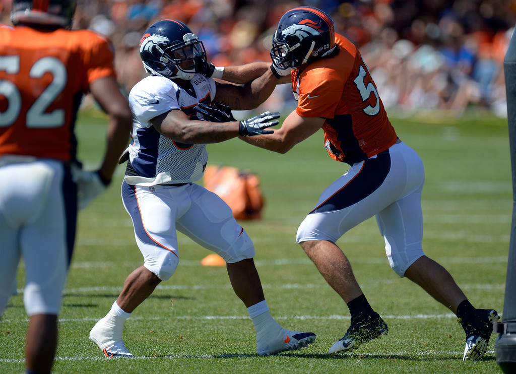 . Denver Broncos RB Lance Ball (35) runs through blocking drills with MLB Stewart Bradley (55) during training camp August 5, 2013 at Dove Valley. (Photo By John Leyba/The Denver Post)