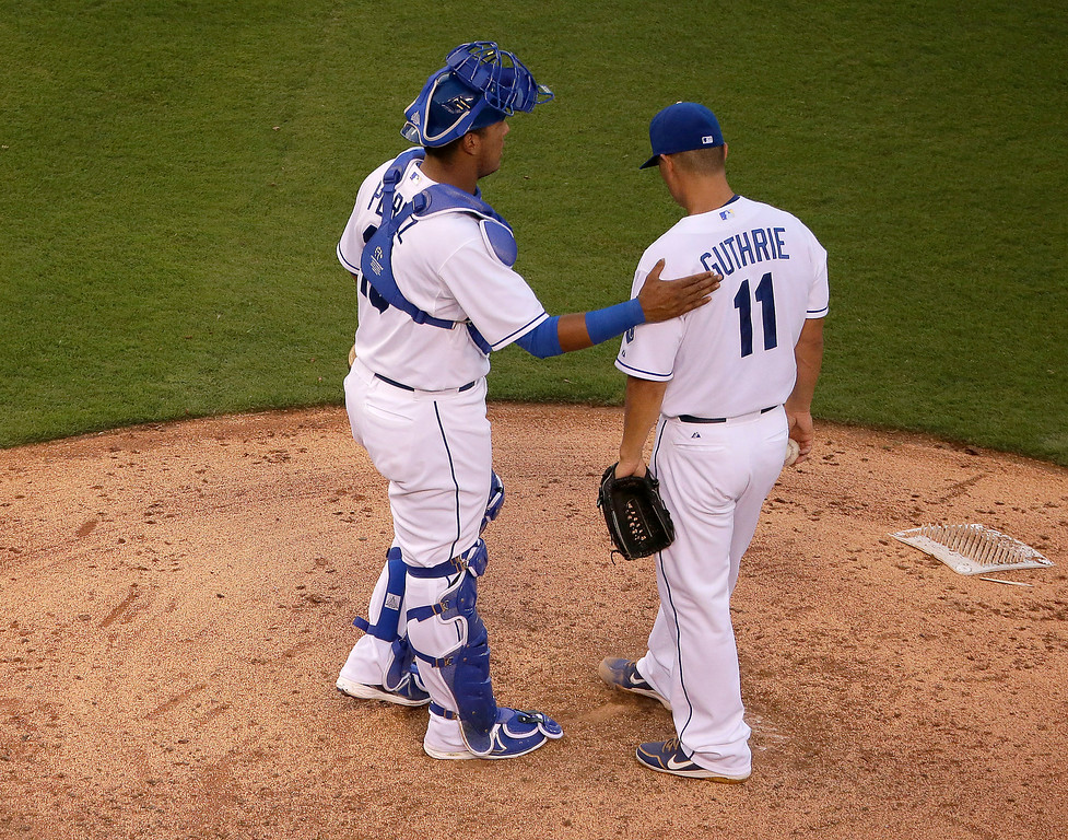 . Kansas City Royals starting pitcher Jeremy Guthrie (11) and catcher Salvador Perez talk on the mound during the fourth inning of a baseball game against the Detroit Tigers Thursday, July 10, 2014, in Kansas City, Mo. (AP Photo/Charlie Riedel)