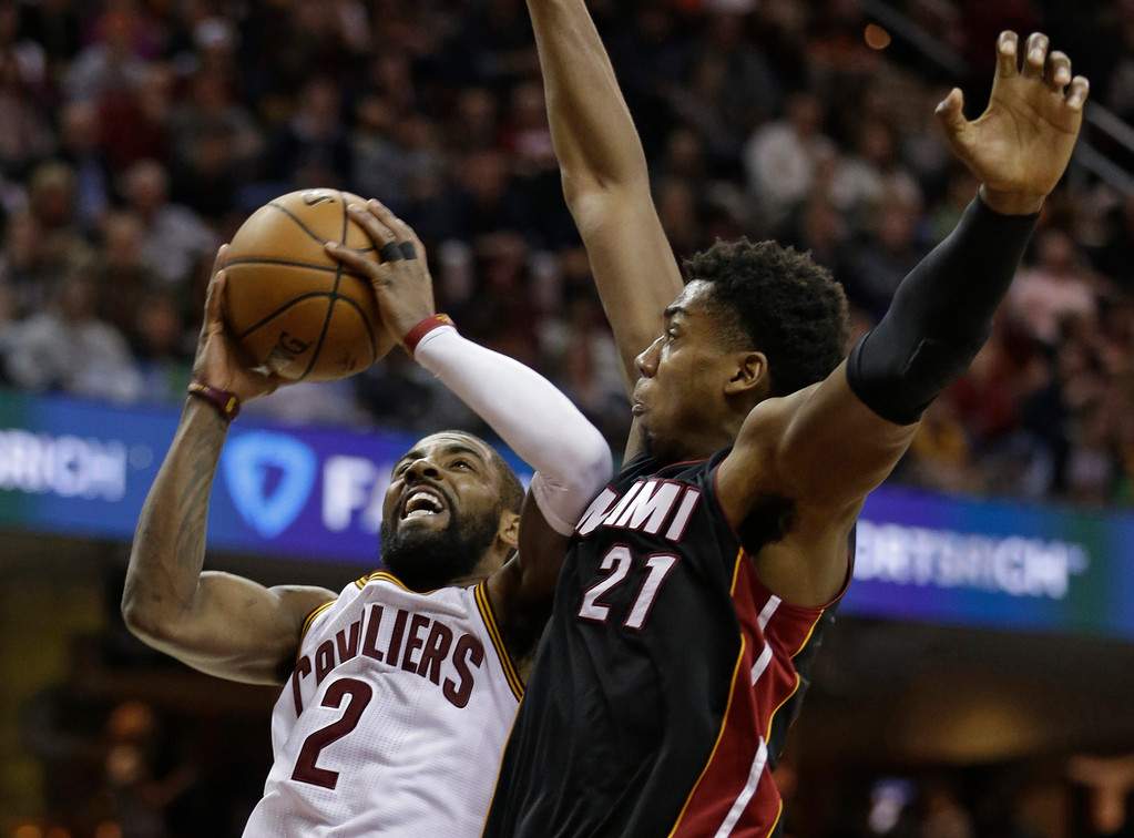 . Cleveland Cavaliers\' Kyrie Irving (2) shoots against Miami Heat\'s Hassan Whiteside (21) in the first half of an NBA basketball game, Monday, March 6, 2017, in Cleveland. (AP Photo/Tony Dejak)