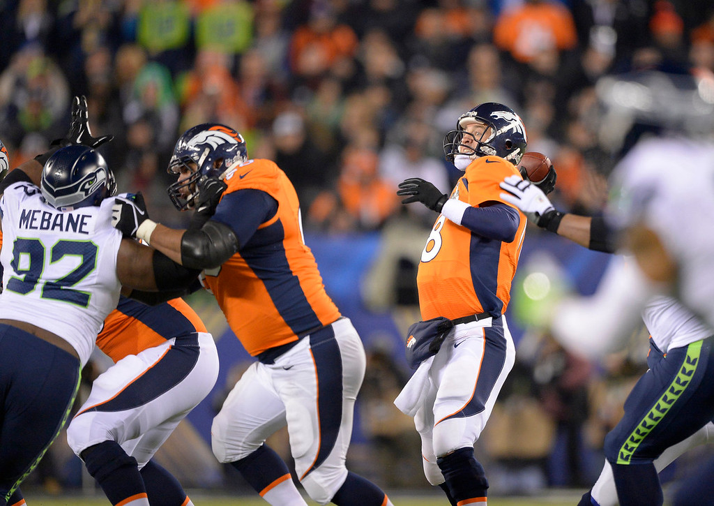 . Denver Broncos quarterback Peyton Manning (18) drops back during the third quarter. The Denver Broncos vs the Seattle Seahawks in Super Bowl XLVIII at MetLife Stadium in East Rutherford, New Jersey Sunday, February 2, 2014. (Photo by John Leyba/The Denver Post)
