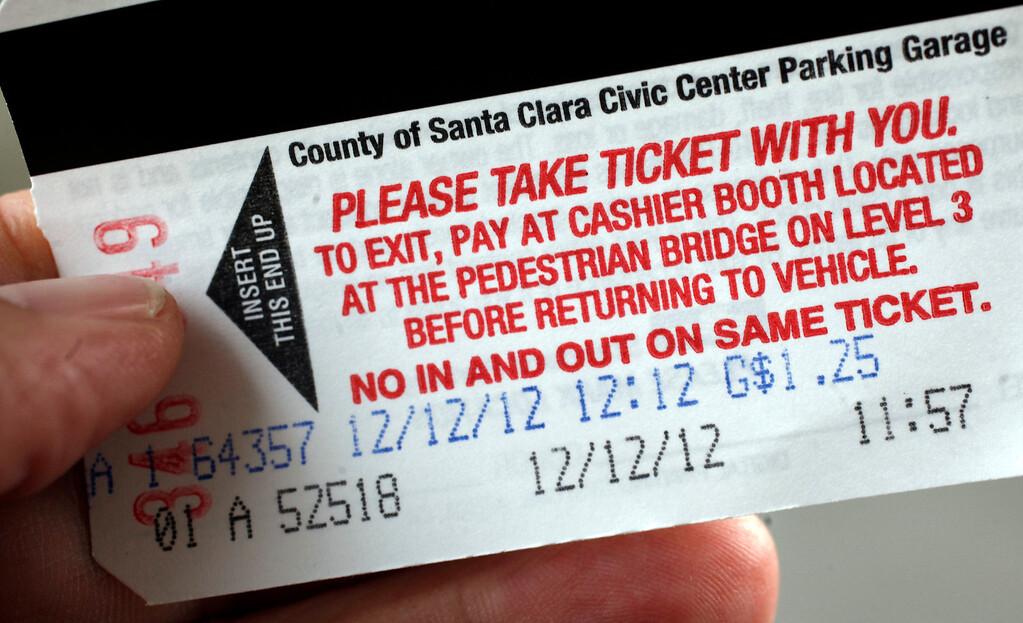 . Ivonne Hernandez processes a parking ticket at the Civic Center garage in San Jose, Calif. at exactly 12:12 pm on Wednesday, December 12, 2012.  (Karl Mondon/Staff)