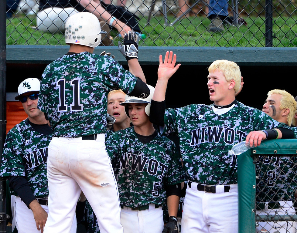 . LAKEWOOD, CO - MAY 23: Niwot\'s Alex Kinnison (11) celebrates his home run with teammates. The Longmont Trojans take on the Niwot Cougars in the 4A Baseball State Semi-Final Championships. (Kathryn Scott Osler, The Denver Post)