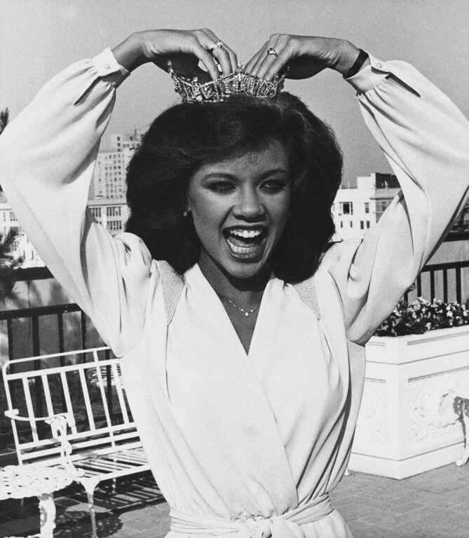 . Vanessa Williams, Miss America for 1984 adjusts her crown during photo session, Sunday, Sept. 19, 1983 in Atlantic City, New Jersey. (AP Photo)
