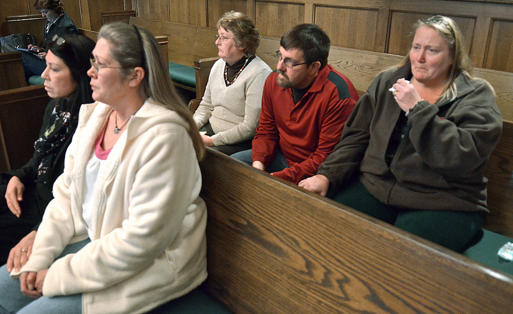 . Jeff Forman/JForman@News-Herald.com William Andrew Fayne Putzbach\'s mother, Cathy Fayne, second from right, and uncle and aunt, Alvin and Lori Bunch, right, listen Feb. 21 in Lake County Common Pleas Court as Nathaniel Brown is convicted on two counts and found innocent on 11 counts in Putzbach\'s killing in 2011. Sitting with them are victim\'s advocates Michelle Corello, first row left, and Peggy Grant, second row left.