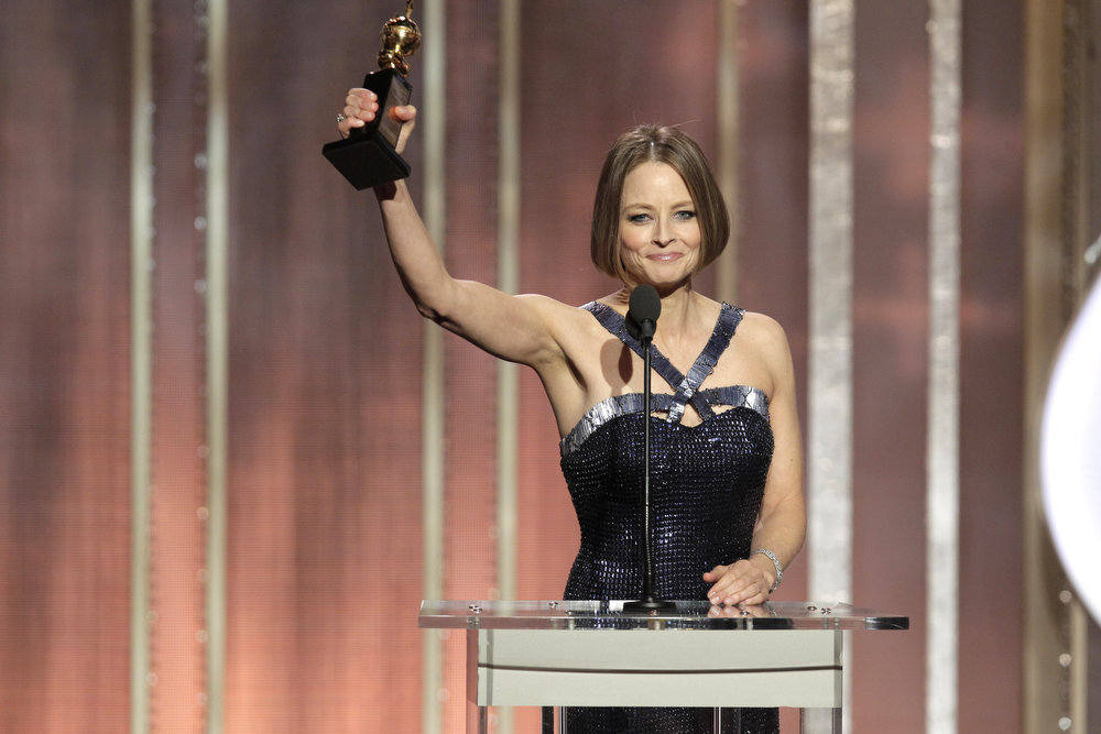 Description of . Actress Jodie Foster receives the Cecil B. DeMille award for lifetime achievement on stage during the 70th Annual Golden Globe Awards at the Beverly Hilton Hotel International Ballroom on January 13, 2013 in Beverly Hills, California. (Photo by Paul Drinkwater/NBCUniversal via Getty Images)