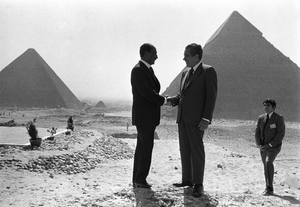 . In this June 14, 1974 file photo taken by Associated Press photographer Horst Faas, Presidents Anwar Sadat and Richard Nixon shake hands for photographers as they pose in front of the pyramids at Giza, near Cairo. Faas, a prize-winning combat photographer who carved out new standards for covering war with a camera and became one of the world\'s legendary photojournalists in nearly half a century with The Associated Press, died Thursday May 10, 2012. He was 79. (AP Photo/Horst Faas)