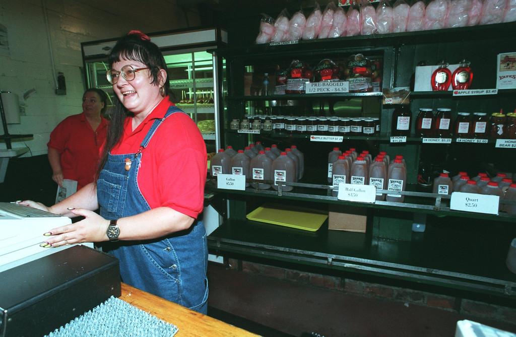 . Yates Cider Mill in Rochester Hills. Karen Miller of Warren helps sell the fresh apple cider and donuts at the Mill.