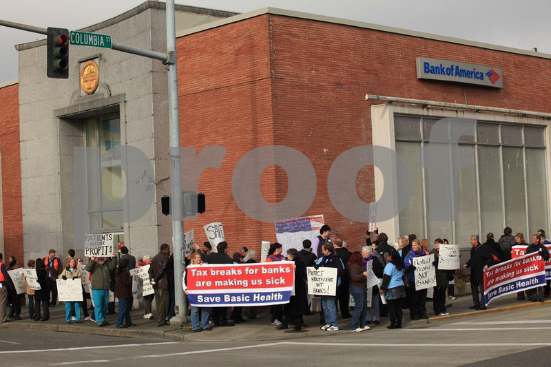 People protesting the health care policies of the Bank of America in Olypmia, WA on Feb. 10, 2011.