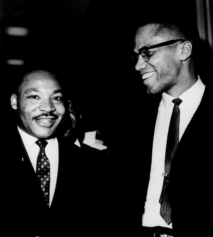 ". The Rev. Martin Luther King, Jr., left, of the Southern Christian Leadership Conference, and Malcolm X, head of a new group known as Muslim Mosque, Inc., smile for photographers March 26, 1964, at the Capitol.  They shook hands after King announced plans for  ""direct action\"" protests if Southern senators filibuster against the civil rights bill.  Malcolm X, who has broken with the Black Muslims, predicted another march on Washington if a filibuster against the civil rights drags on.  (AP Photo/Henry Griffin)"