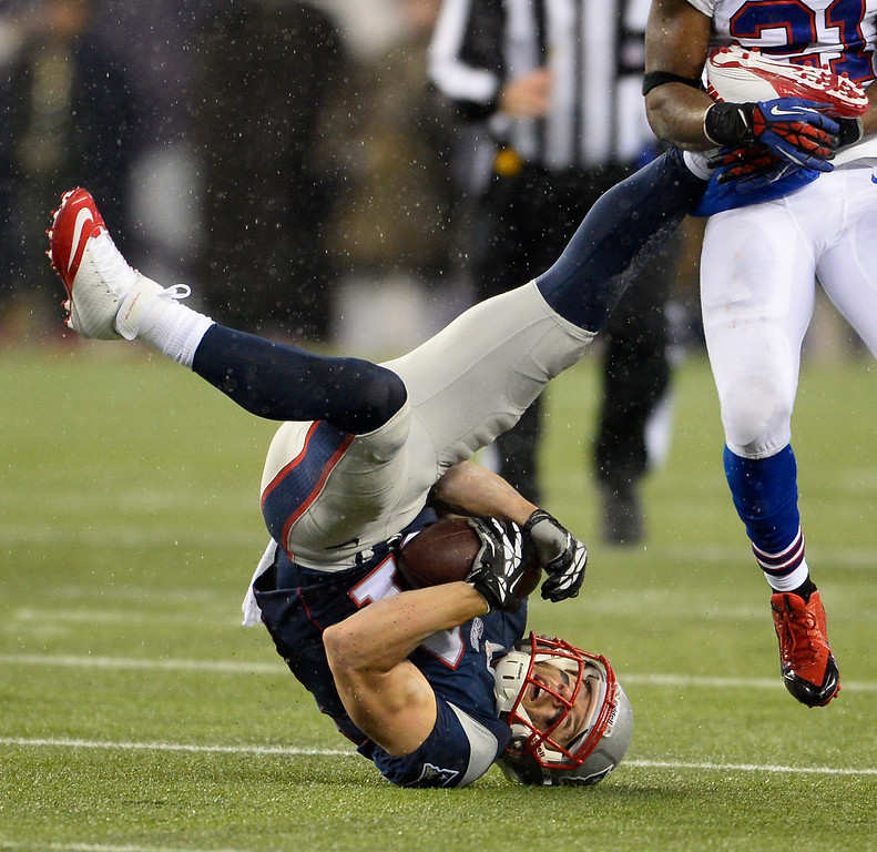 . New England Patriots wide receiver Julian Edelman flips over after making a reception during the first quarter against the Buffalo Bills at Gillette Stadium in Foxborough, Massachusetts, USA 29 December 2013.  EPA/CJ GUNTHER
