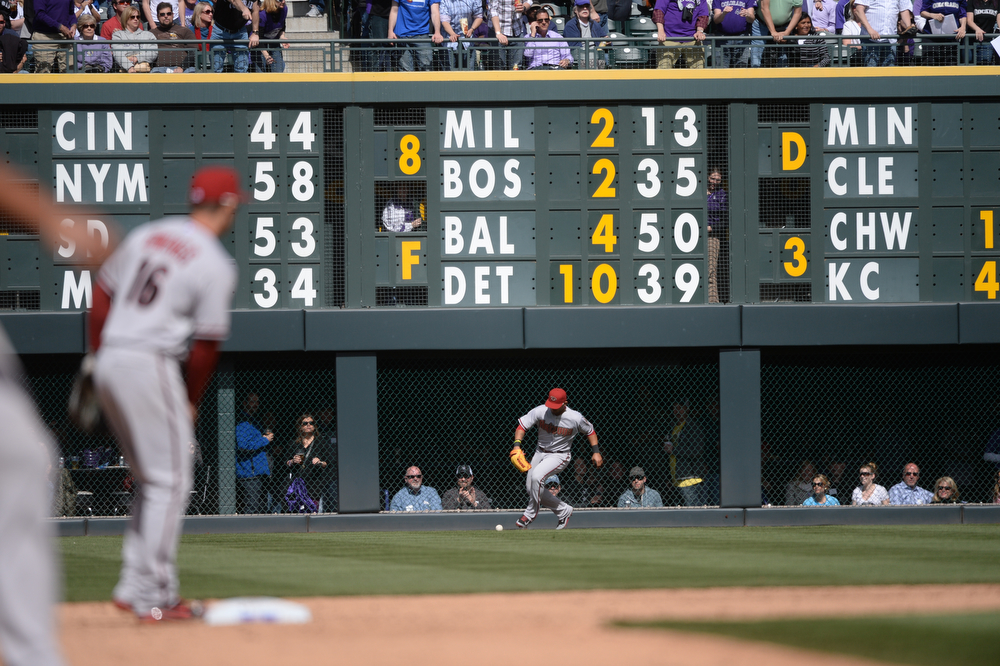 . Diamondbacks Gerardo Parra tracks down a ball after it bounced off of the outfield wall after a triple by Carlos Gonzalez during the third inning. The Colorado Rockies hosted the Arizona Diamondbacks in the Rockies season home opener at Coors Field in Denver, Colorado Friday, April 4, 2014. (Photo by Karl Gehring/The Denver Post)